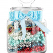 Stock Photo: Glass jar containing various beads isolated on white