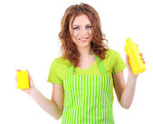 Young housewife with cleaner and sponge isolated on white — Stock Photo