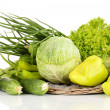 Fresh green vegetables on wicker mat isolated on white - Stock Photo