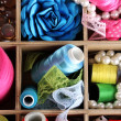 Thread and material for handicrafts in box close-up — Stock Photo #23186928