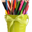 Colorful pencils and felt-tip pens in green pail isolated on white — Stock Photo #23187072