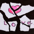 Torn paper with words Love close-up on wooden table — Stock Photo