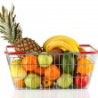 Fresh  fruit in metal basket isolated on white background - Stock Photo