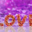 Word Love on purple background — Stock Photo
