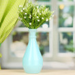 Decorative flowers in vase on windowsill — Stock Photo