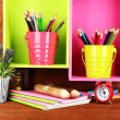 Colorful pencils in pails on shelves on wooden background — Stok fotoğraf