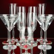 Cocktail and wine glasses, on dark red background — Stock Photo