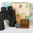 Black modern binoculars with map and compass isolated on white — Stock Photo #23189790