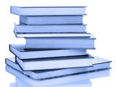 Stack of books in blue light — Stock Photo