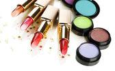 Beautiful lipsticks and eye shadows isolated on white — Stock Photo