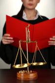 Judge read verdict on grey background — Stock Photo