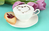 Composition of coffee, toast and tulips on color background — Stock Photo