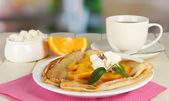 Cup of tea and pancakes with orange — Stock Photo