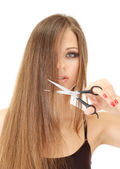 Beautiful woman with long hair and hairdresser's scissors, isolated on white — Stock Photo
