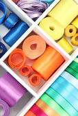 Bright silk ribbons in white wooden box, close up — Stock Photo