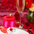 Table setting in honor of Valentine's Day on red background — Stock Photo