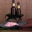 Aromatherapy setting on brown bamboo background - Stok fotoğraf
