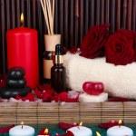 Beautiful spa setting near pool on bamboo background — Stock Photo