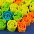 Zdjęcie stockowe: Colorful quilling on blue background close-up
