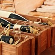 Bottles of old red wine in gift wooden box, on stone background — ストック写真