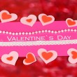 Greeting card for Valentine&#039;s Day on red background - Stock Photo