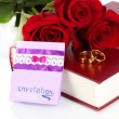 Wedding rings with roses and greeting card on bible isolated on white - Stock Photo