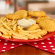 Fried chicken nuggets with french fries and sauce on table in cafe - Foto de Stock