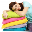 Beautiful young girl with pillows isolated on whit — Stock Photo #23193276