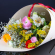 Bouquet of various flowers on dark background - Foto de Stock
