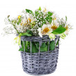 Bouquet of flowers in basket isolated on white - Foto de Stock