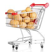 Batatas maduras no trole isolado no branco — Fotografia Stock
