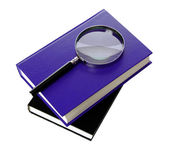Magnifying glass and book isolated on white — Stock Photo