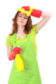 Tired young woman holding sprayer, isolated on white — Stock Photo