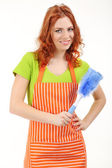 Young woman wearing apron with brush isolated on white — Stock Photo