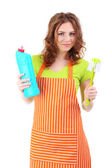 Young housewife with cleaning supplies, isolated on white — Stock Photo