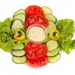 Chopped vegetables and sauce on plate isolated on white — Stock Photo