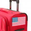 Red suitcase with sticker with flag of USA isolated on white — Stock Photo
