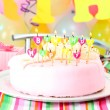 Sweet birthday with candles cake on plate - Zdjęcie stockowe