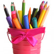 Colorful pencils and felt-tip pens in pink pail isolated on white — Stock Photo #23325924
