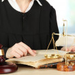 Judge sitting at table during court hearings on room background — Stock Photo