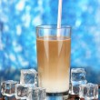 Cold coffee with ice in glass on blue background — Stock Photo #23326900