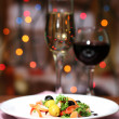 Tasty salad on dark background with bokeh  defocused lights — Stock Photo