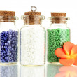 Little bottles full with colorful beads isolated on white — Stock Photo #23327332