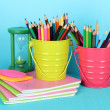 Colorful pencils with school supplies on blue background — Foto de Stock