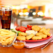Fried chicken nuggets with vegetables,cola,french fries and sauce on table in cafe — Stock Photo