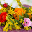 Beautiful flowers on bright background - Stock Photo