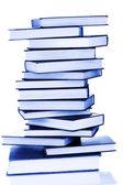 Torre de livros isolado no fundo branco — Fotografia Stock