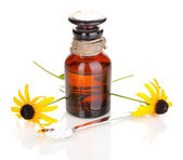 Medicine bottle with tablets and flowers isolated on white — Foto Stock