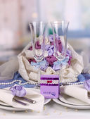 Serving fabulous wedding table in purple color of the restaurant background — Stock Photo
