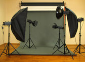 Photo studio with lighting equipment — Stock Photo